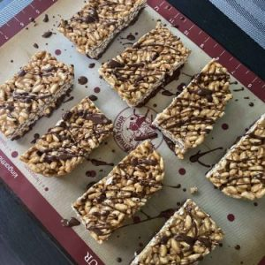 Peanut Butter chocolate rice crispy treats on a serving tray