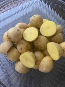 Halved baby potatoes in a bowl
