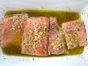 salmon marinating in a shallow dish