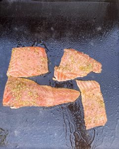 salmon cooking on blackstone griddle
