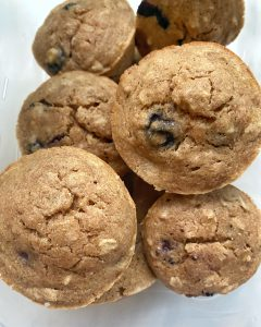 muffins stacked in a tupper ware