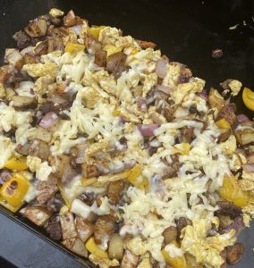 finished sausage and potato breakfast scramble on the blackstone griddle