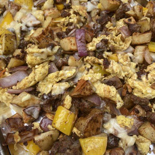 sausage and potato blackstone breakfast scramble on a pan