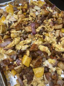 sausage and potato blackstone breakfast scramble completed recipe on pan
